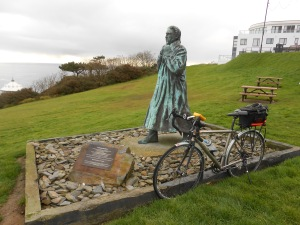 Sir William Hillary over looking Douglas Bay, with Enid my bike snuggled up to the paving slab beside.